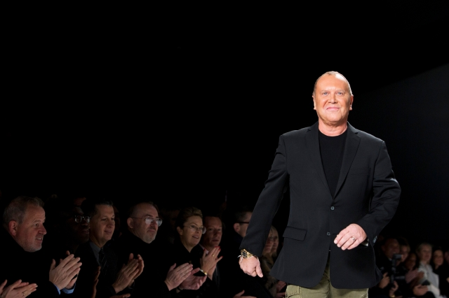 Designer Michael Kors greets the audience following his Autumn/Winter 2013 collection show during New York Fashion Week in this file photo