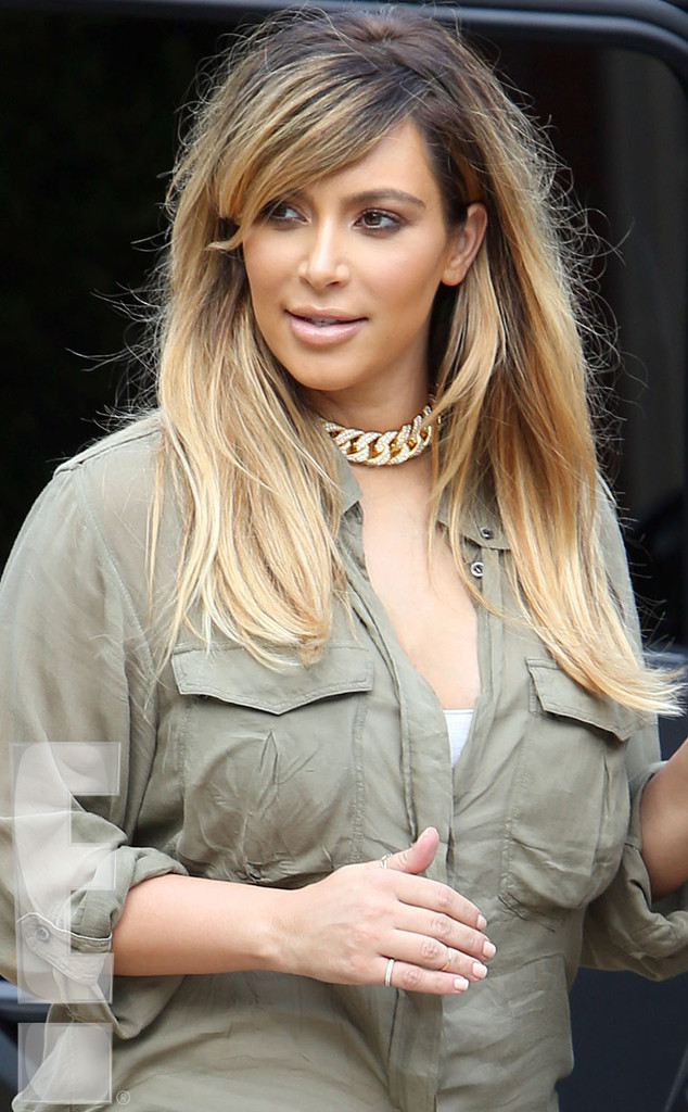 rs_634x1024-130903090915-634.3kim-kardashian-blonde-north.ls.9313_copy